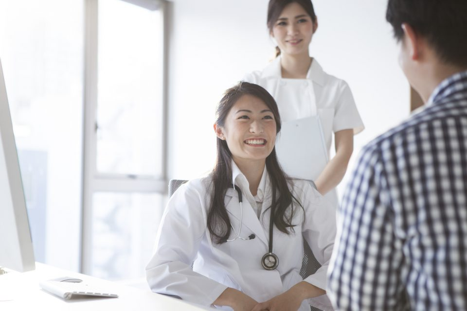 Female doctors are interview to the patient in the examination room