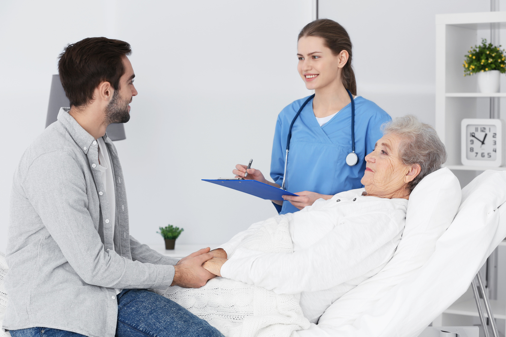 Grandmother, grandson and doctor at hospital