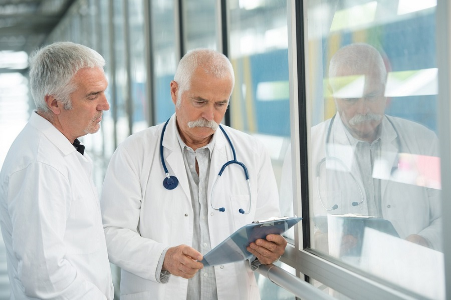 two doctors at hospital with clipboard