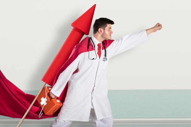 Superhero Doctor With First Aid Box While Flying On Rocket