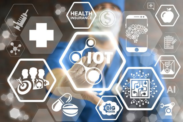 Internet of Things (IoT) Health Care Concept. Doctor pressing icon IOT nano atom on virtual screen. Smart hospital, intelligent clinic. Digital IT medicine. Medical information technology.