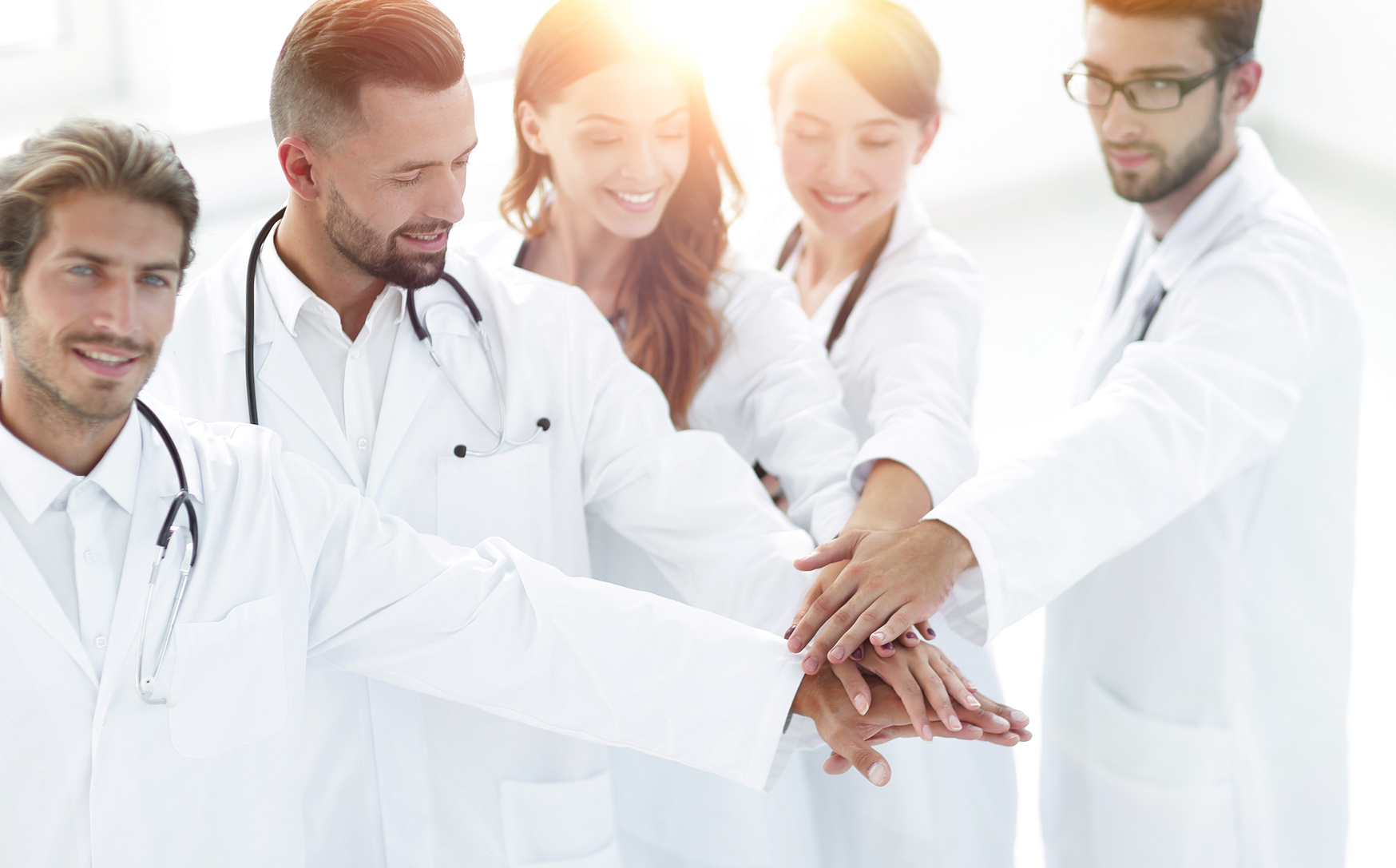 Joyful doctors are proud of their teamwork