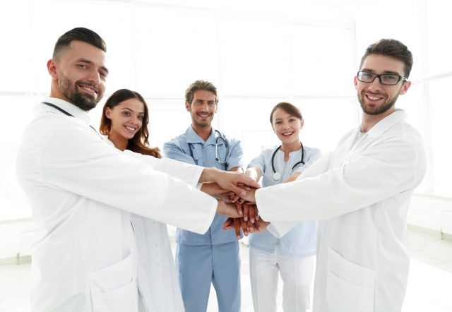 background image of a successful group of doctors on a white background.photo with copy space