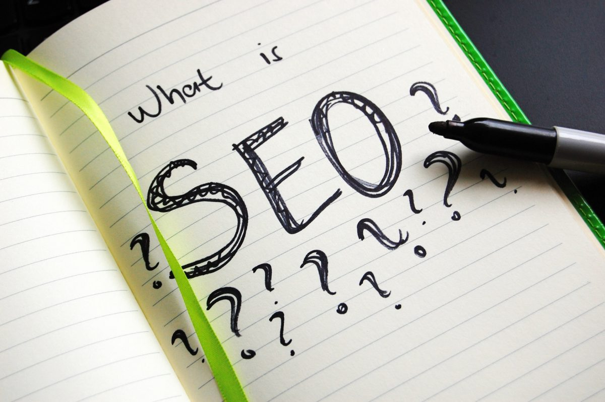page in the notebook with SEO abbreviation and question marks
