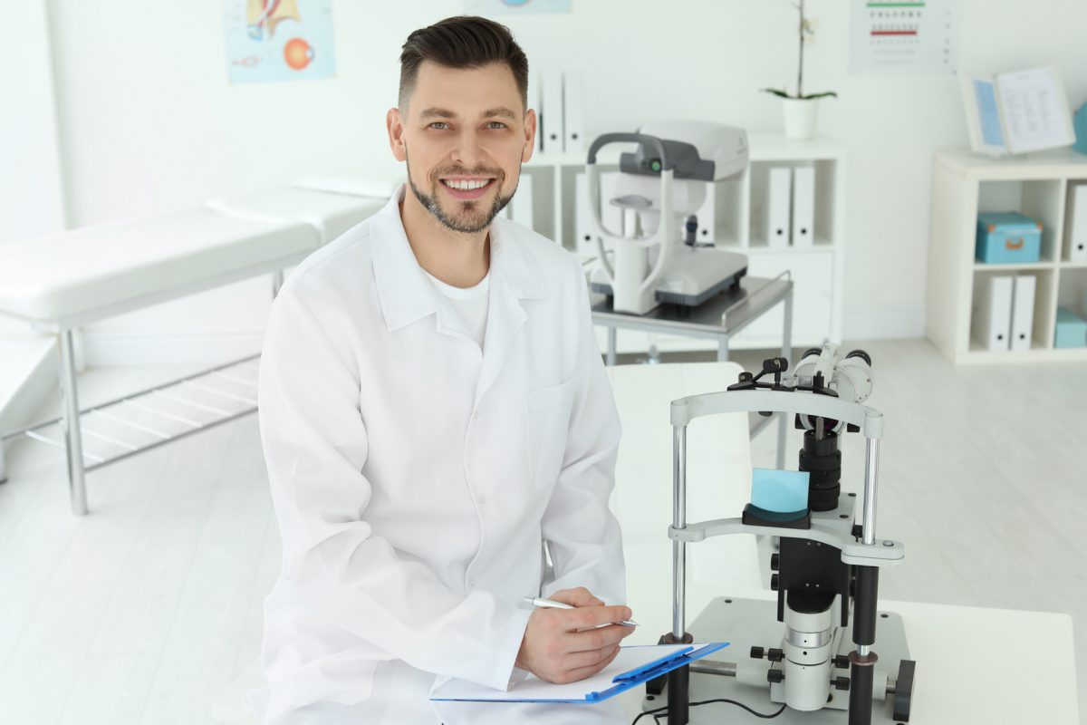 Ophthalmologist with modern equipment in clinic
