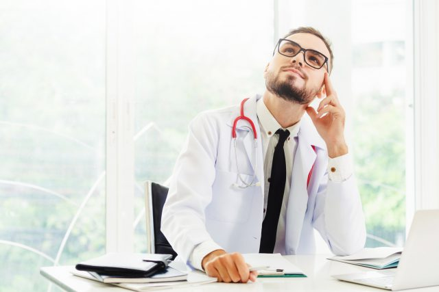 Doctor thinking while working in hospital.