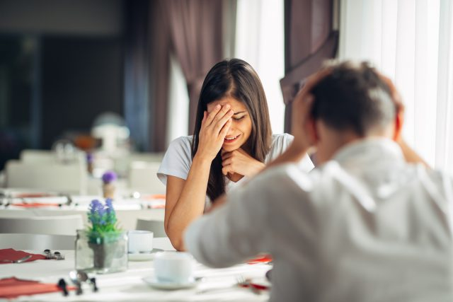 Crying stressed woman in fear,having a conversation with a man about problems.Reaction to negative event,handling bad news.Breaking up relationship.Emotional sad troubled woman expression.Miscarriage
